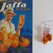 Ruwe Turquoise in oranje zilveren oorbellen